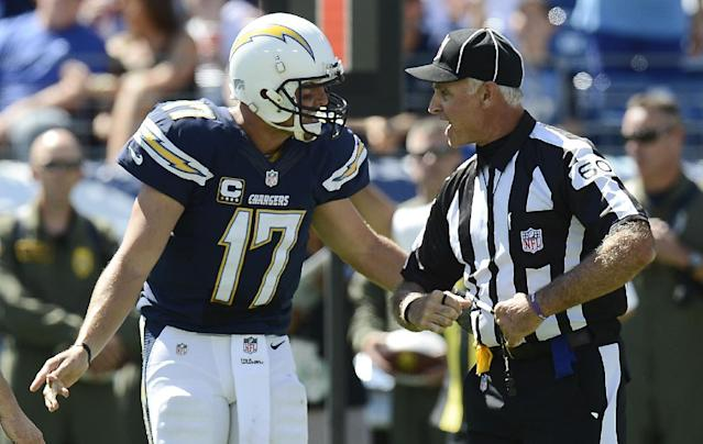 San Diego Chargers quarterback Philip Rivers (17) argues with field judge Gary Cavaletto (60) after an offensive pass interference call against the Chargers in the second quarter of an NFL football game against the Tennessee Titans on Sunday, Sept. 22, 2013, in Nashville, Tenn. Rivers was penalized for unsportsmanlike conduct as a result. (AP Photo/Mark Zaleski)