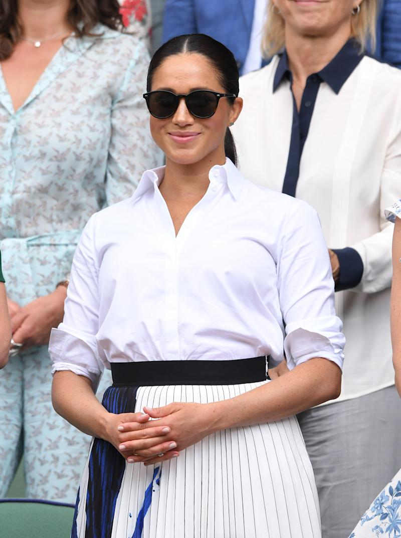 LONDON, ENGLAND - JULY 13: Meghan, Duchess of Sussex in the Royal Box on Centre Court during day twelve of the Wimbledon Tennis Championships at All England Lawn Tennis and Croquet Club on July 13, 2019 in London, England. (Photo by Karwai Tang/Getty Images)