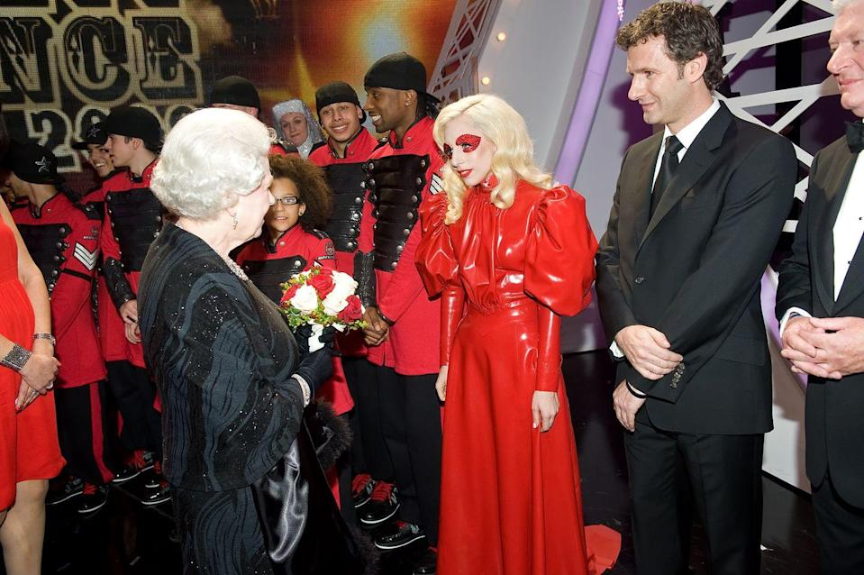 <p>At the peak of Lady Gaga's kooky outfits (the meat dress would appear the following year), the singer met Queen Elizabeth after the Royal Variety Performance wearing a cherry-red latex gown accompanied by matching red bedazzled eye makeup.</p>