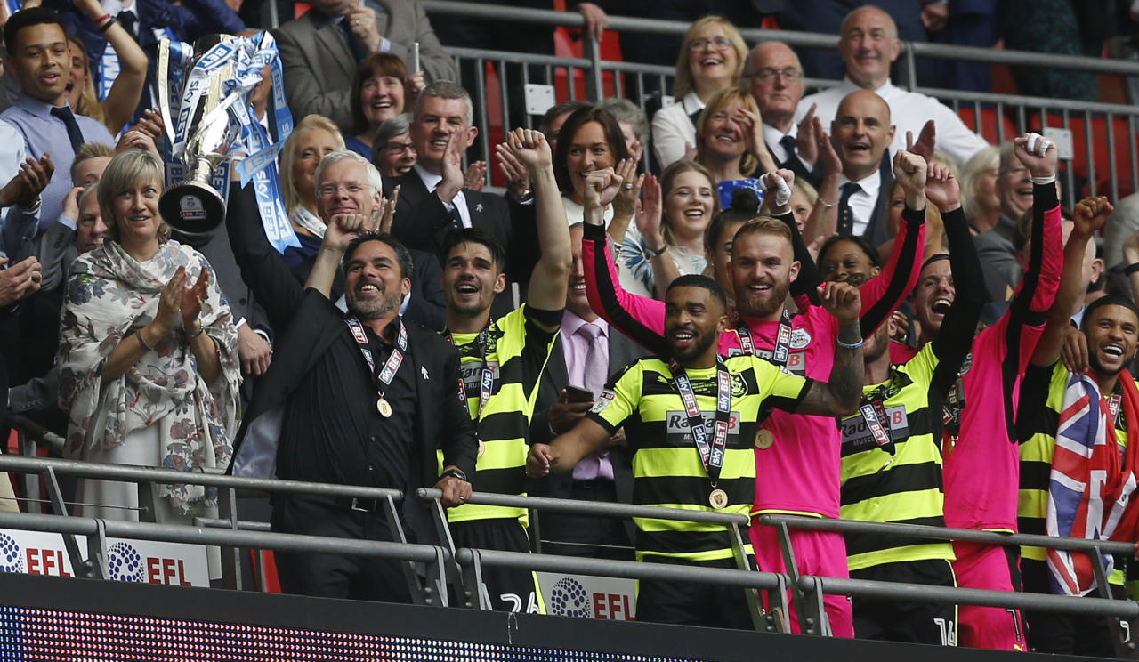 """Britain Football Soccer - Reading v Huddersfield Town - Sky Bet Championship Play-Off Final - Wembley Stadium, London, England - 29/5/17 Huddersfield Town manager David Wagner and players celebrate with the trophy after winning the Sky Bet Championship Play-Off Final and getting promoted to the Premier League  Action Images via Reuters / Matthew Childs Livepic EDITORIAL USE ONLY. No use with unauthorized audio, video, data, fixture lists, club/league logos or """"live"""" services. Online in-match use limited to 45 images, no video emulation. No use in betting, games or single club/league/player publications.  Please contact your account representative for further details."""