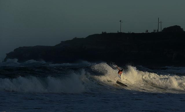 SYDNEY, AUSTRALIA - JANUARY 29: A surfer rides a wave at Coogee Beach after winds and rain battered Sydney last night generating large swell January 29, 2013 in Sydney, Australia. Parts of Sydney are experienced record rainfall after ex-cyclone Oswald swept through the city last night. (Photo by Mark Metcalfe/Getty Images)