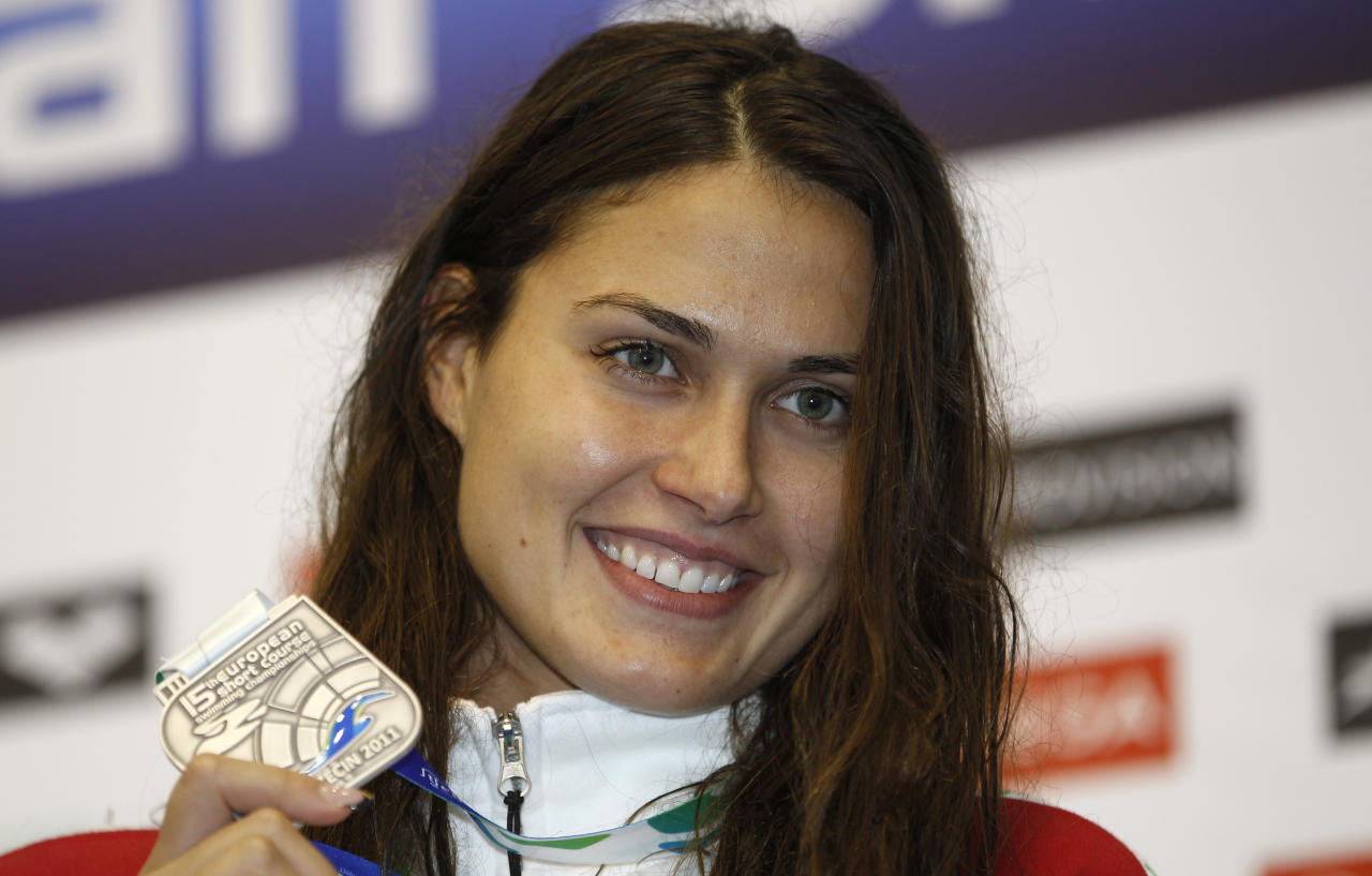 Hungary's Zsuzsanna Jakabos shows off her silver medal during the ceremony for the Women's 4x50 Individual Medley final during the European Short Course Swimming Championships in Szczecin, Poland, Saturday, Dec. 10, 2011. (AP Photo/Michael Sohn)