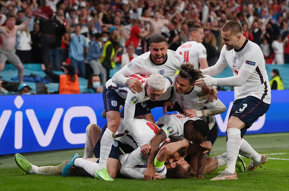 LONDON, ENGLAND - JULY 07: Harry Kane of England is congratulated after scoring his team's second goal by Jordan Henderson, Phil Foden, Kyle Walker, Jack Grealish, Raheem Sterling and Luke Shaw during the UEFA Euro 2020 Championship Semi-final match between England and Denmark at Wembley Stadium on July 07, 2021 in London, England. (Photo by Laurence Griffiths/Getty Images)