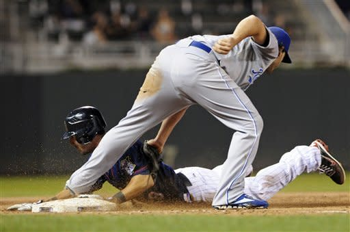 Kansas City Royals third baseman Mike Moustakas, right, tags Minnesota Twins' Darin Mastroianni on an attempted steal of third base in the fifth inning of a baseball game, Tuesday, Sept. 11, 2012, in Minneapolis. (AP Photo/Jim Mone)
