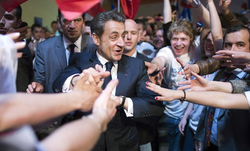 French President and conservative candidate for the 2012 French presidential elections Nicolas Sarkozy arrives to deliver a speech at a political campaign rally in Le Raincy, near Paris, Thursday, April 26, 2012. (AP Photo/Lionel Bonaventure,Pool)