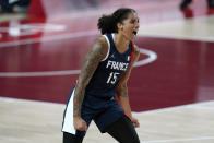 France's Gabrielle Williams (15) celebrates at the end of a women's basketball quarterfinal round game against Spain at the 2020 Summer Olympics, Wednesday, Aug. 4, 2021, in Saitama, Japan. (AP Photo/Charlie Neibergall)