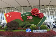 An installation to celebrate the 70th anniversary of the founding of the People's Republic of China is seen outside the new Beijing Daxing International Airport in Beijing on September 25, 2019. (Photo by STR / AFP) / China OUT (Photo credit should read STR/AFP via Getty Images)