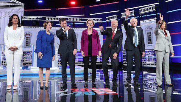 PHOTO: Democratic presidential candidates arrive on stage before the start of the Democratic Presidential Debate, Nov. 20, 2019, in Atlanta. (Joe Raedle/Getty Images)