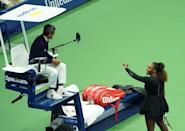 Serena Williams argues with chair umpire Carlos Ramos on her way to defeat to Japan's Naomi Osaka in the US Open final. (AFP Photo/kena betancur)