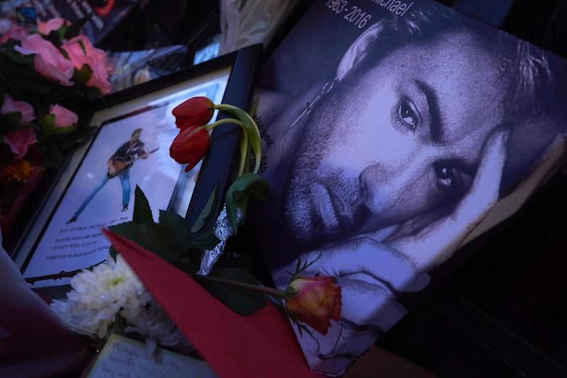 Tributes: Flowers, candles and other messages were left by well-wishers in tribute outside the singer's home in north London. (AFP/Getty Images)