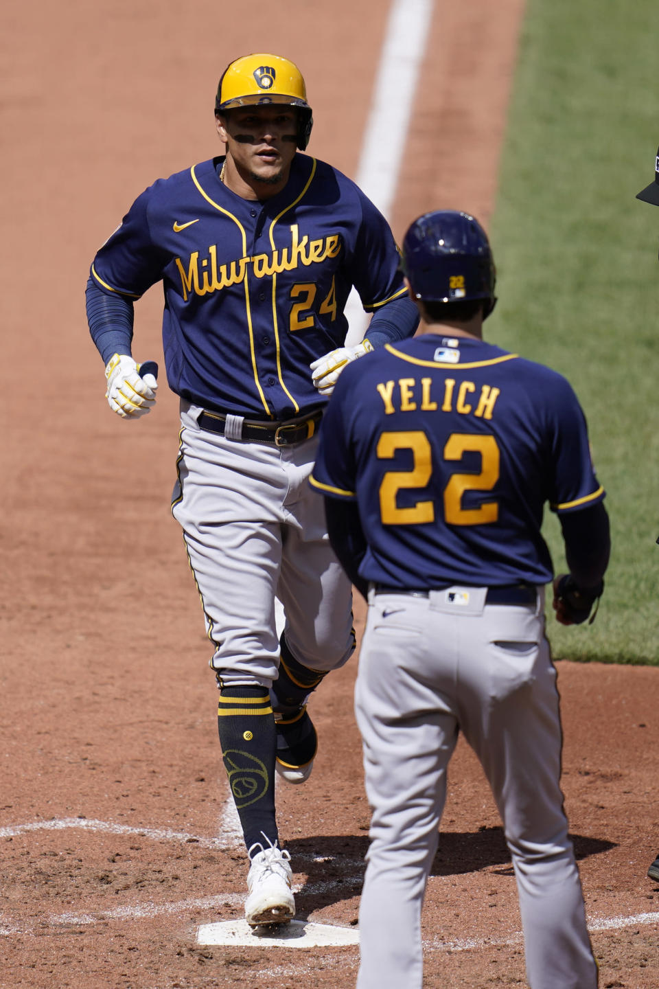 Milwaukee Brewers' Avisail Garcia (24) is congratulated by teammate Christian Yelich (22) after hitting a two-run home run during the fifth inning of a baseball game against the St. Louis Cardinals Saturday, April 10, 2021, in St. Louis. (AP Photo/Jeff Roberson)