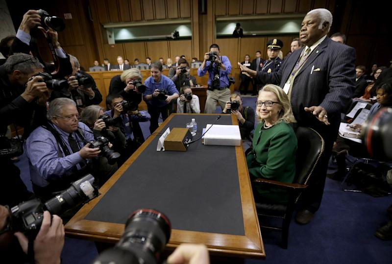 Secretary of State Hillary Rodham Clinton takes her seat on Capitol Hill, Wednesday, Jan. 23, 2013, prior to testifying before the Senate Foreign Relations Committee hearing on the deadly September attack on the U.S. diplomatic mission in Benghazi, Libya, that killed Ambassador Chris Stevens and three other Americans. (AP Photo/Pablo Martinez Monsivais)