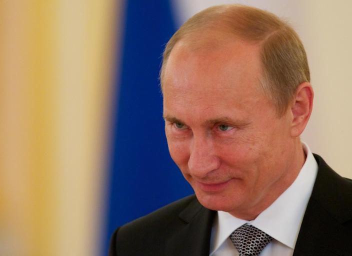 Russian President Vladimir Putin is seen during a ceremony of receiving credentials in Moscow's Kremlin on Wednesday in Moscow, Russia, Wednesday, Sept. 26, 2012. Russian President Vladimir Putin has renewed calls for a joint international solution to civil conflict in the Middle East in a veiled rejection of Western demands for an end to Syrian leader Bashar Assad's rule. Putin said Wednesday that incitement to the continuation of violence with a view to securing regime change would only create further unrest. (AP Photo/Alexander Zemlianichenko, pool)