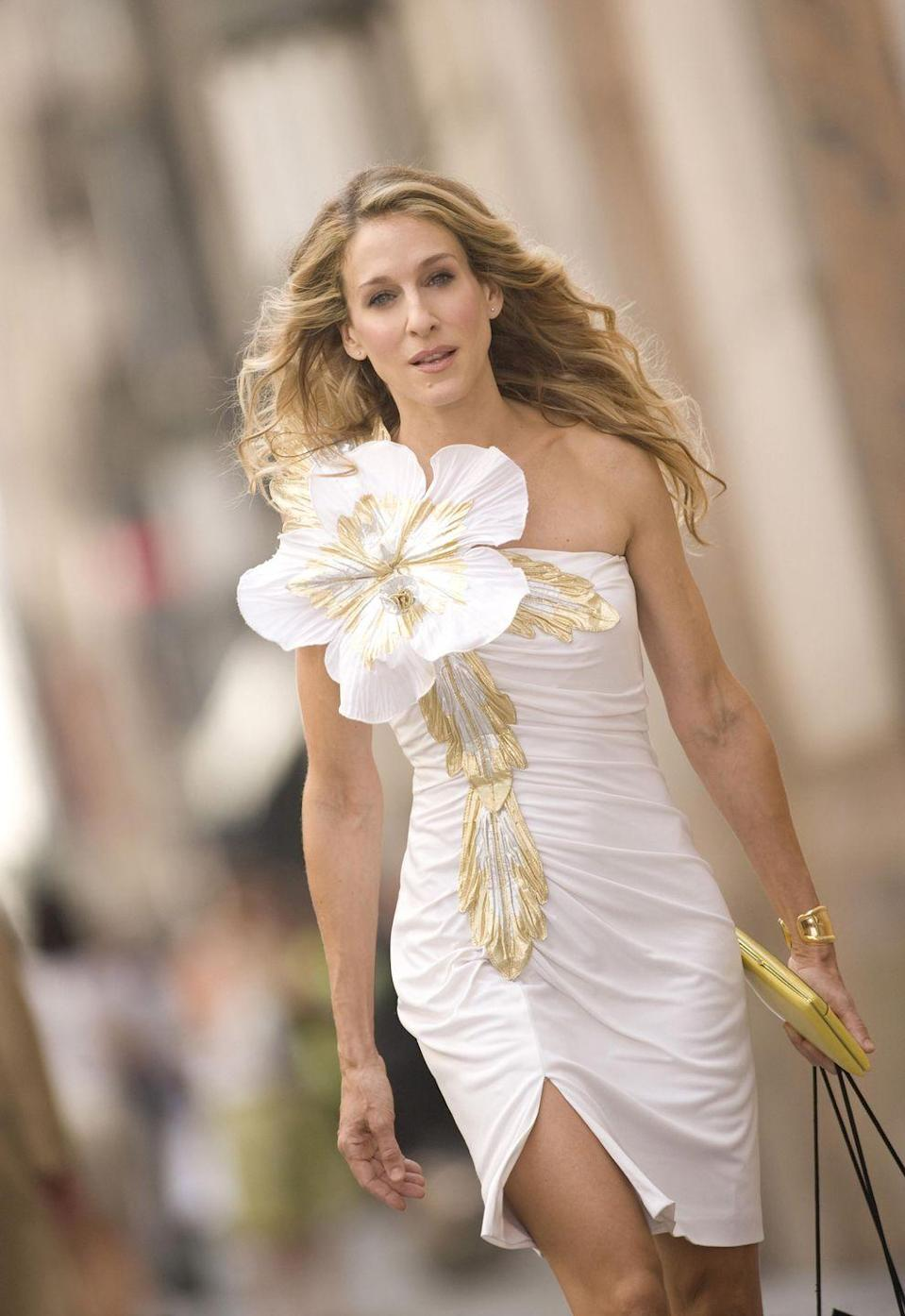 <p>For the opening credits of the first Sex and the City movie, Carrie swapped her famous pink tutu for a white Eugene Alexander dress and a gold Elsa Peretti bone cuff from Tiffany & Co. </p><p>In a series, and subsequently a film, where New York is arguably one of the most important characters, putting Carrie in one of the city's most venerable jeweller's iconic designs was a stroke of styling genius. </p>