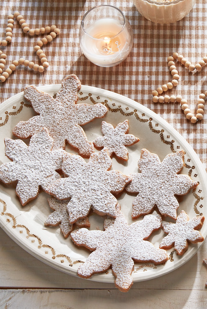 """<p>Think of these as the more elegant cousin to sugar cookies. With a rich, toasted-nut taste and a simple dusting of sugar, they're irresistibly good.</p><p><strong><a href=""""https://www.countryliving.com/food-drinks/a29643034/pecan-snowflake-cookies-recipe/"""" rel=""""nofollow noopener"""" target=""""_blank"""" data-ylk=""""slk:Get the recipe"""" class=""""link rapid-noclick-resp"""">Get the recipe</a>.</strong></p><p><strong><a class=""""link rapid-noclick-resp"""" href=""""https://www.amazon.com/dp/B01GVUYOW2/r?tag=syn-yahoo-20&ascsubtag=%5Bartid%7C10050.g.647%5Bsrc%7Cyahoo-us"""" rel=""""nofollow noopener"""" target=""""_blank"""" data-ylk=""""slk:SHOP COOKIE CUTTERS"""">SHOP COOKIE CUTTERS</a><br></strong></p>"""