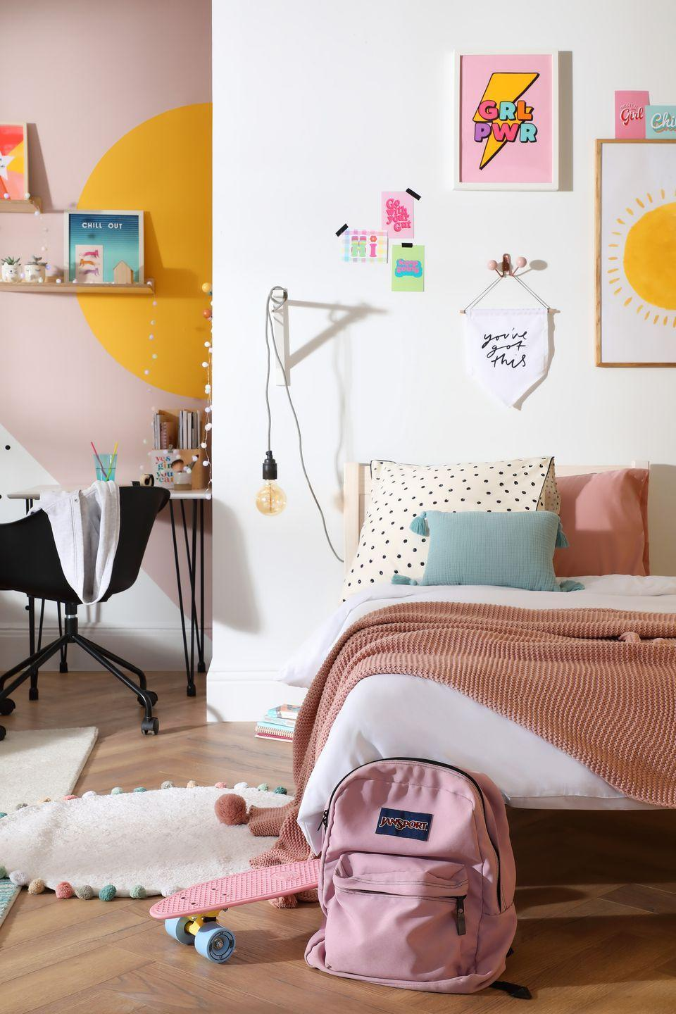 """<p>With home schooling coming to the fore during the pandemic, finding a suitable desk space to do school and homework has become ever so important. While the bed is against the white wall, the room is zoned to create a separate area workspace. A pink and white colour scheme with a yellow semicircle brings personality to this girls bedroom.</p><p>Pictured: Rio White Washed Single Bed, <a href=""""https://go.redirectingat.com?id=127X1599956&url=https%3A%2F%2Fwww.furniturechoice.co.uk%2Fbedroom%2Fbeds%2Frio-white-washed-single-bed_wb10000814&sref=https%3A%2F%2Fwww.housebeautiful.com%2Fuk%2Fdecorate%2Fbedroom%2Fg35589644%2Fgirls-bedroom-ideas%2F"""" rel=""""nofollow noopener"""" target=""""_blank"""" data-ylk=""""slk:Furniture and Choice"""" class=""""link rapid-noclick-resp"""">Furniture and Choice</a></p>"""