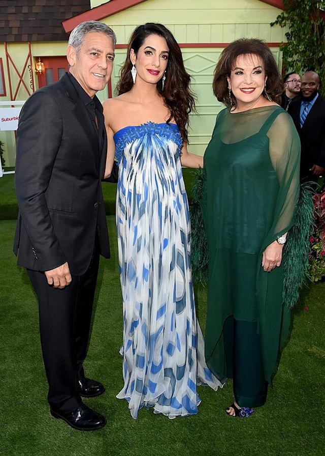 <p>The<em> Suburbicon</em> producer and director was escorted to the premiere of his new movie by his stunning wife, Amal, and her equally beautiful mom on Sunday. That's one way to earn points with the mother-in-law, George! (Photo: Kevin Winter/Getty Images) </p>