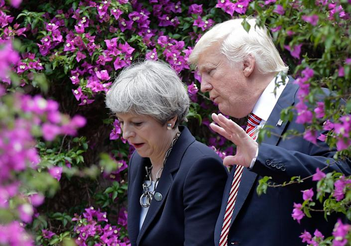 <p>President Donald Trump, right, talks with British Prime Minister Theresa May in Taormina, Italy, Friday, May 26, 2017. Leaders of the G7 meet Friday and Saturday, including newcomers Emmanuel Macron of France and Theresa May of Britain in an effort to forge a new dynamic after a year of global political turmoil amid a rise in nationalism. (Photo: Luca Bruno/AP) </p>