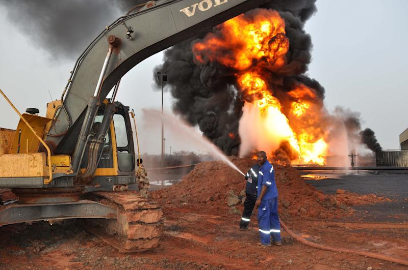 In this Sunday, April 22, 2012 photo, fire billows up from an oil field that caught on fire in Heglig, Sudan. An official says Sudanese jets bombed three areas in South Sudan's Unity State, including a major oil field. South Sudan military spokesman Col. Philip Aguer said Antonov bombers accompanied by MiG 29 jets bombed the town of Abiemnom in Unity State and the Unity State oil field. (AP Photo/Abd Raouf)