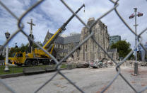 FILE - In this Feb. 25, 2011, file photo, the earthquake damaged Christ Church Cathedral in Christchurch, New Zealand. The Christ Church Cathedral was arguably New Zealand's most iconic building before much of it crumbled during an earthquake 10 years ago. The years of debate that followed over whether the ruins should be rebuilt or demolished came to symbolize the paralysis that has sometimes afflicted the broader rebuild of Christchurch. But as the city on Monday, Feb. 22, 2021 marks one decade since the quake struck, killing 185 people and upending countless more lives, there are finally signs of progress on the cathedral. It's being rebuilt to look much like the original that was finished in 1904, only with modern-day improvements to make it warmer and safer. (AP Photo/Rob Griffith, File)