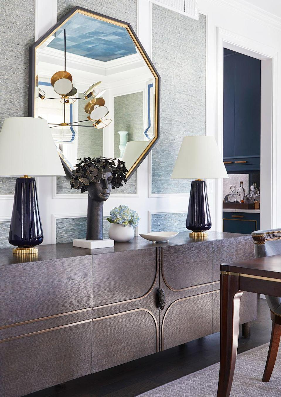 "<p>Dinging rooms are another great place for console tables, as you can always use an extra spot for additional plating and florals. Whether you opt for a classic console or a buffet like<a href=""https://coreydamenjenkins.com/"" rel=""nofollow noopener"" target=""_blank"" data-ylk=""slk:Corey Damen Jenkins"" class=""link rapid-noclick-resp""> Corey Damen Jenkins</a> did here (the latter is a popular option for its bonus storage capacity), consider adding a lamp for extra task lighting that's still stylish. </p>"