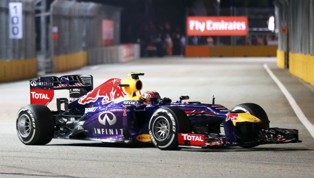 Red Bull Formula One driver Mark Webber of Australia drives during the qualifying session of the Singapore F1 Grand Prix at the Marina Bay street circuit in Singapore September 21, 2013. REUTERS/Natashia Lee (SINGAPORE - Tags: SPORT MOTORSPORT F1)