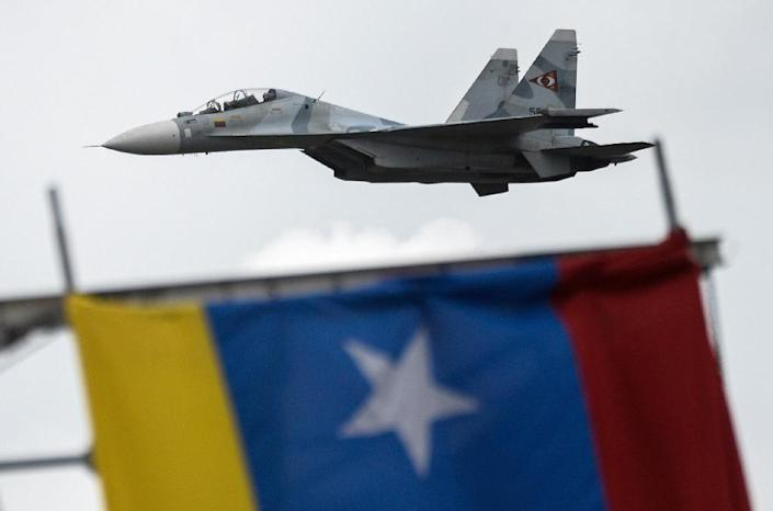 In this file picture taken on July 5, 2017, a Russian-made Venezuelan Air Force Sukhoi Su-30MKV multirole strike fighter overflies a military parade in Caracas (AFP Photo/Federico PARRA)