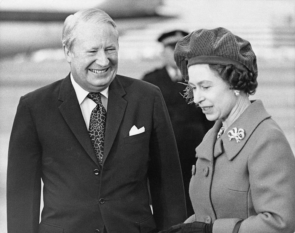 Queen Elizabeth II with British Prime Minister Edward Heath (1916 - 2005) at Heathrow Airport, London, 28th January 1974. The Queen is about to take a flight to Canada. (Photo by Keystone/Hulton Archive/Getty Images)