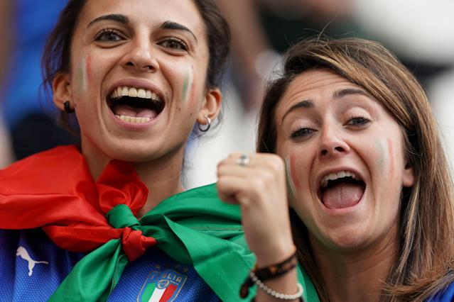Italian supporters pose ahead of the France 2019 Women's World Cup Group C football match between Jamaica and Italy, on June 14, 2019, at the Auguste-Delaune Stadium in Reims, eastern France. (Photo by Lionel Bonaventure/AFP/Getty Images)