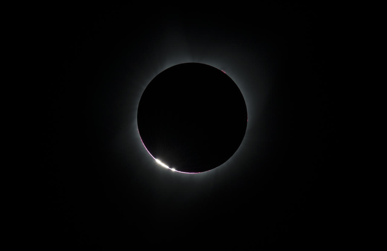 <p>The Bailey's Beads effect is seen as the moon makes its final move over the sun during the total solar eclipse above Madras, Oregon. A total solar eclipse swept across a narrow portion of the contiguous United States from Lincoln Beach, Oregon to Charleston, South Carolina. Photo from Getty Images </p>