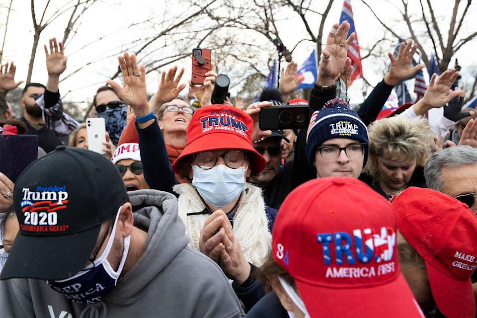 People gather in support of President Donald Trump and in protest the outcome of the 2020 presidential election outside the Supreme Court in Washington, DC.