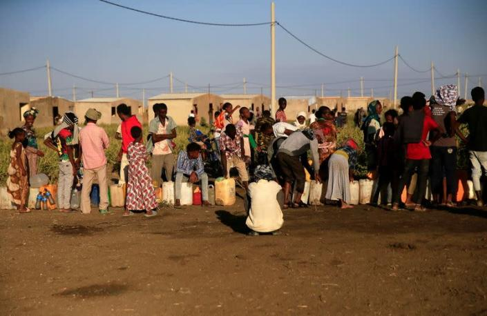 Ethiopian refugees fleeing from the ongoing fighting in Tigray region, queue for water, at the Fashaga camp, on the Sudan-Ethiopia border, in Kassala state
