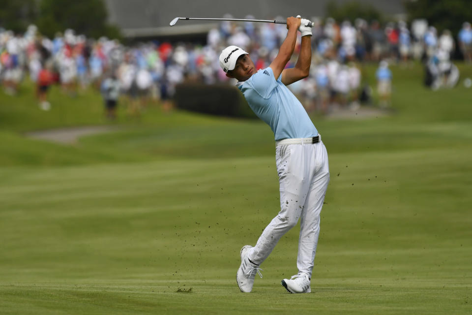 Collin Morikawa hits on the 10th hole during the second round in the World Golf Championship-FedEx St. Jude Invitational tournament, Friday, Aug. 6, 2021, in Memphis, Tenn. (AP Photo/John Amis)