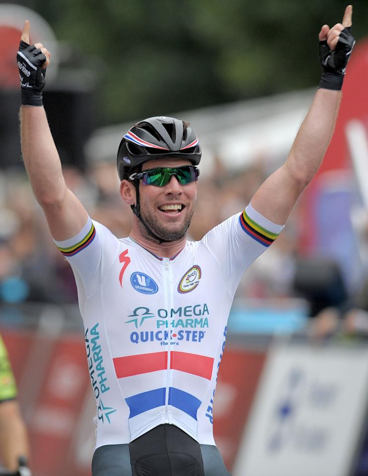 Omega Pharma-Quick Step's Mark Cavendish celebrates winning stage eight of the 2013 Tour of Britain in London.