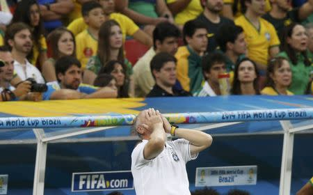Brazil's coach Luiz Felipe Scolari reacts as his team plays against the Netherlands during their 2014 World Cup third-place playoff at the Brasilia national stadium in Brasilia July 12, 2014. REUTERS/Ueslei Marcelino