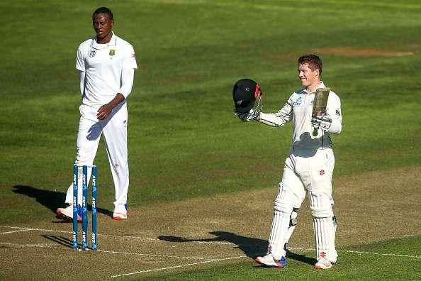 WELLINGTON, NEW ZEALAND - MARCH 16: Henry Nicholls of New Zealand celebrates his maiden test century while Kagiso Rabada of South Africa looks on during day one of the Test match between New Zealand and South Africa at Basin Reserve on March 16, 2017 in Wellington, New Zealand. (Photo by Hagen Hopkins/Getty Images)