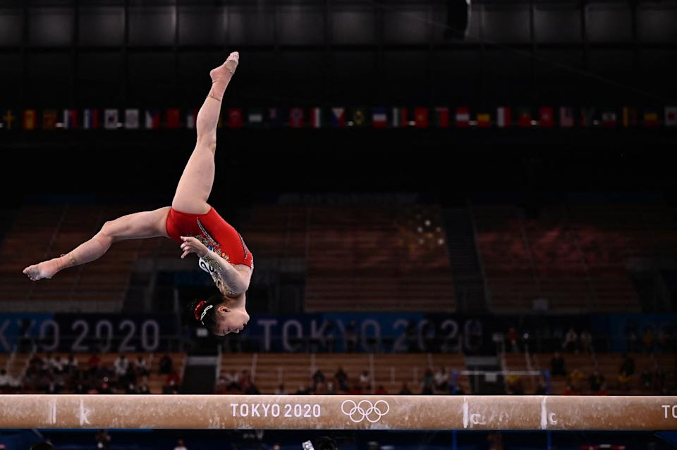 China's Guan Chenchen competes in the artistic gymnastics women's balance beam final at the 2020 Tokyo Olympics.