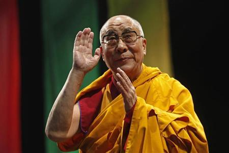 """The Dalai Lama greets the audience before his conference """"A guide to the way of life of Bodhisattva"""" in Mexico City"""