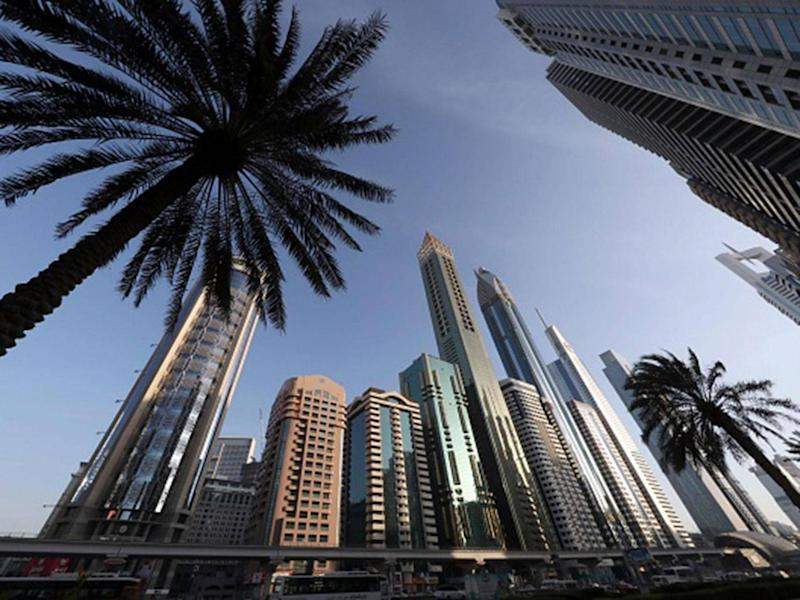 The 75-storey Gevora Hotel, the central gold tower with reflective cladding, which stands 356 metres or nearly a quarter of a mile tall (Getty Images )