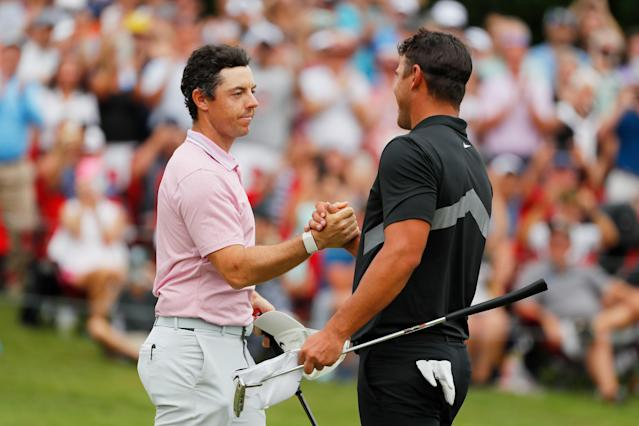 """<h1 class=""""title"""">TOUR Championship - Final Round</h1> <div class=""""caption""""> ATLANTA, GEORGIA - AUGUST 25: Brooks Koepka of the United States congratulates Rory McIlroy of Northern Ireland on the 18th green after McIlroy won the FedEx Cup and Tour Championship during the final round of the TOUR Championship at East Lake Golf Club on August 25, 2019 in Atlanta, Georgia. (Photo by Kevin C. Cox/Getty Images) </div> <cite class=""""credit"""">Kevin C. Cox</cite>"""