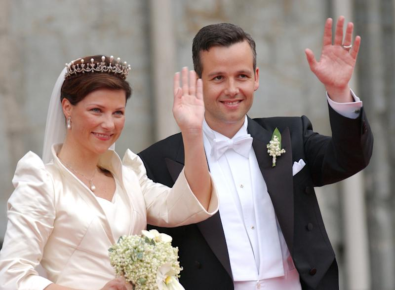 A photo of Princess Martha Louise Of Norway and Ari Behn waving to the crowds on on their wedding day on May 24, 2016 in Trondheim