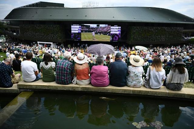 The big screen at Wimbledon is flanked by two new living walls (AFP Photo/Daniel LEAL-OLIVAS)