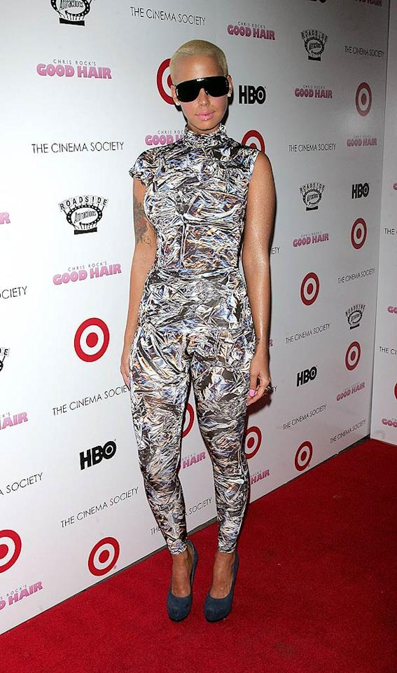 "Kanye West's gal pal Amber Rose delivered yet another fashion faux pas upon arriving at a screening of ""Good Hair"" in this seizure-inducing sleeveless jumpsuit. Jim Spellman/<a href=""http://www.wireimage.com"" target=""new"">WireImage.com</a> - October 5, 2009"