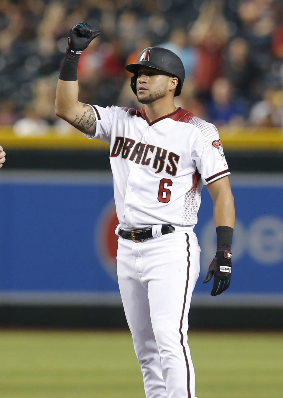 Arizona Diamondbacks' David Peralta reacts after hitting an RBI double against the Los Angeles Dodgers in the fourth inning during a baseball game, Wednesday, June 5, 2019, in Phoenix. (AP Photo/Rick Scuteri)