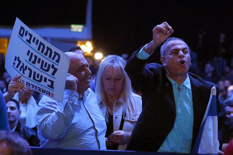 Members of Israel's Labour Party disrupt a speech by chairman Avi Gabbay during a party conference in Tel Aviv on January 10, 2019 (AFP Photo/JACK GUEZ)