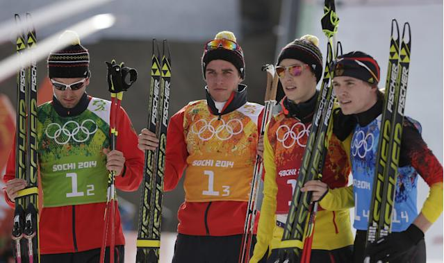 Germany's team Bjoern Kircheisen, Johannes Rydzek, Eric Frenzel, and Fabian Riessle, from left, pose for a photograph after winning the silver during the cross-country portion of the Nordic combined Gundersen large hill team competition at the 2014 Winter Olympics, Thursday, Feb. 20, 2014, in Krasnaya Polyana, Russia. (AP Photo/Matthias Schrader)