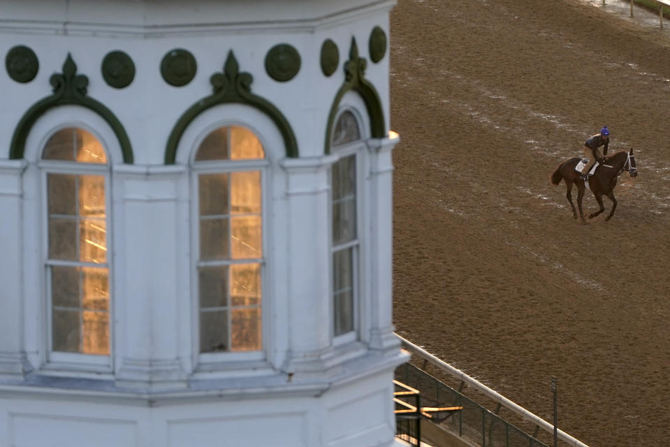 A horse works out at Churchill Downs Friday, April 30, 2021, in Louisville, Ky. The 147th running of the Kentucky Derby is scheduled for Saturday, May 1. (AP Photo/Charlie Riedel)