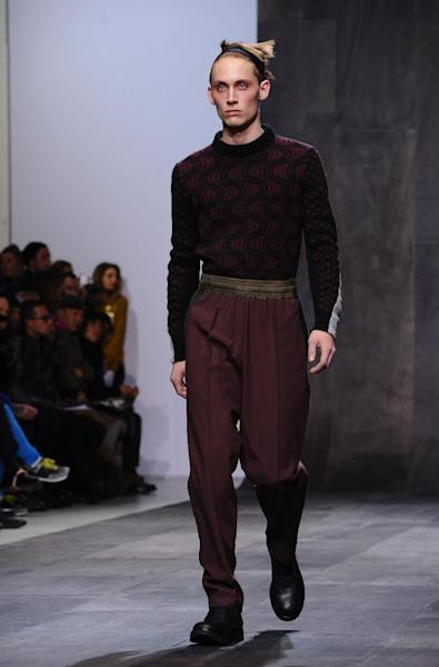 A model wears a creation by fashion designer Damir Doma as part of his fall-winter 2013/2014 men's fashion collection, in Paris, Saturday, Jan. 19, 2013. (AP Photo/Zacharie Scheurer)