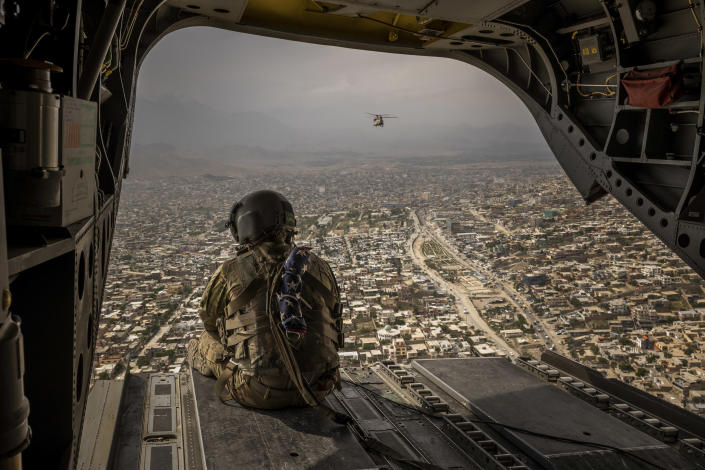 A U.S. Army helicopter over Kabul, Aghanistan, May 2, 2021. (Jim Huylebroek/The New York Times)