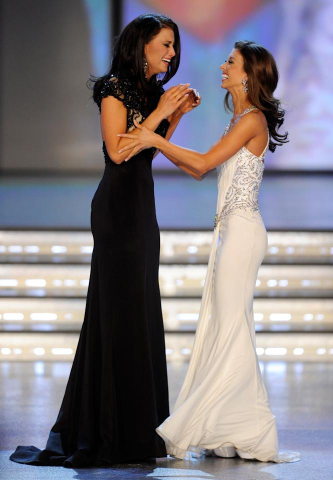 LAS VEGAS, NV - JANUARY 14:  Laura Kaeppeler (L), Miss Wisconsin, and Betty Thompson, Miss Oklahoma react as Kaeppeler is named the new Miss America and Thompson the first runner-up during the 2012 Miss America Pageant at the Planet Hollywood Resort & Casino January 14, 2012 in Las Vegas, Nevada.  (Photo by Ethan Miller/Getty Images)